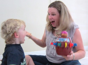 speech pathologist and child surprised